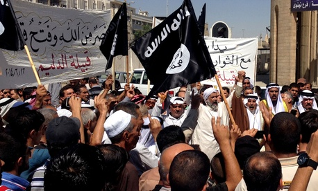 Demonstrators chant pro-ISIL slogans during a rally June 16 in Baghdad.