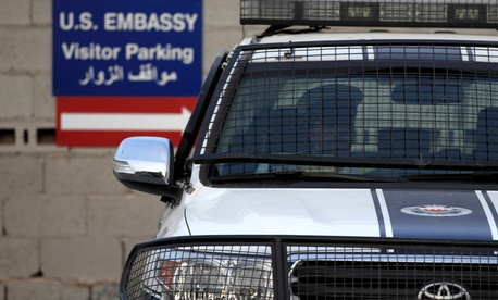 A Bahraini police officer sits in a police car at a new checkpoint near the U.S. Embassy in Manama, Bahrain, in 2013.