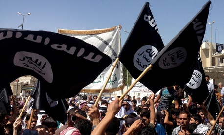 Demonstrators wave ISIL flags during a Baghdad rally earlier this month.
