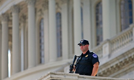 A Capitol Hill police officer stands guard on Capitol Hill in Washington.