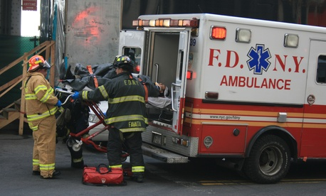 New York fire department staff work after a ferry accident in 2013.
