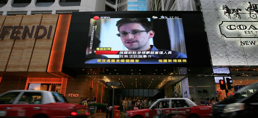 Edward Snowden's face is shown on an outdoor screen in Hong Kong in 2013.