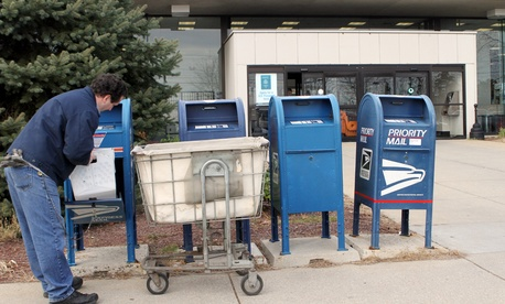 A postal worker in New Hampshire sorts mail in 2011.