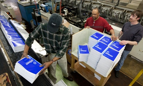 Government Printing Office employees work on copies of President Barack Obama's fiscal 2013 budget book