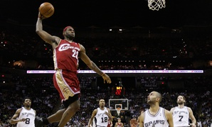 LeBron James attempts a dunk in 2009 against the Spurs in his original run with the Cleveland Cavaliers.