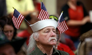 Vietnam veteran Louis Albin, who served in the U.S. Navy, listens during a town hall meeting in Phoenix concerning health-care issues at the Phoenix VA facilities.