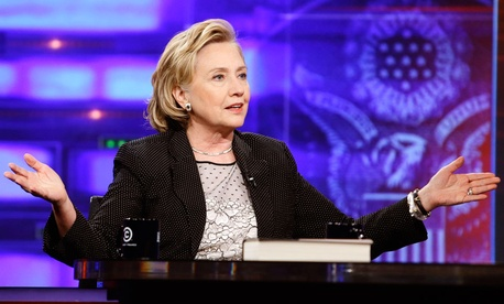 "Former U.S. Secretary of State Hillary Rodham Clinton gestures while speaking to host Jon Stewart during a taping of ""The Daily Show with Jon Stewart."""