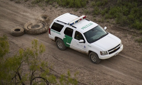 A South Texas Border Patrol vehicle removes tracks in 2013.