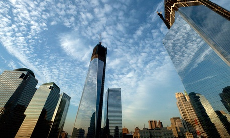 One World Trade Center, center, rises above the National September 11 Memorial and Museum at the World Trade Center in New York.