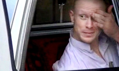 Sgt. Bowe Bergdahl, sits in a vehicle guarded by the Taliban in eastern Afghanistan.
