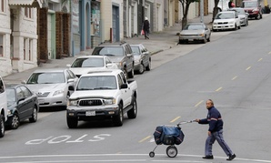 Postal worker Daryl Ha delivers mail in the North Beach area of San Francisco in 2011.