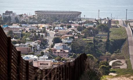 The border fence separates Tijuana from California.
