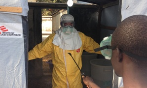 A doctor works in Guinea's forest region during the Ebola outbreak in March.