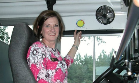 Lora Weaver of the Northeast Alabama Traffic Safety Office points to a yellow dot inside an Autauga County school bus.