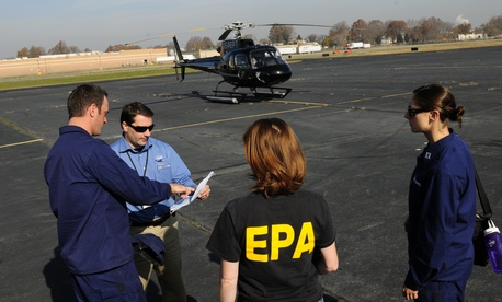 EPA staff accompanied Coast Guard staff on a regulatory flight in New York in 2012.