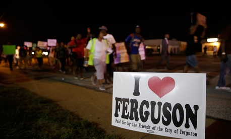 Protestors march Thursday in Ferguson.