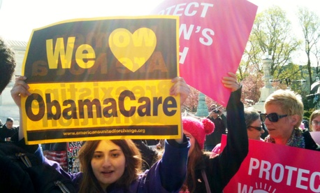 Women rally in support of Obamacare in front of the Supreme Court in 2012.
