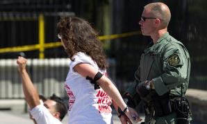 emonstrators are arrested outside the White House Thursday.