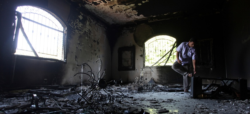 A Libyan man investigates the inside of the U.S. Consulate in Benghazi after it was attacked in September, 2012.
