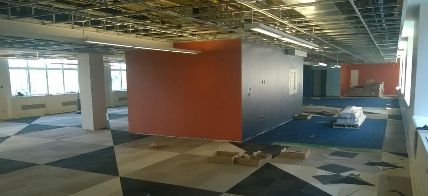 The first phase of the project involved creating an open space with low-walled work stations for rank-and-file employees and executives alike.