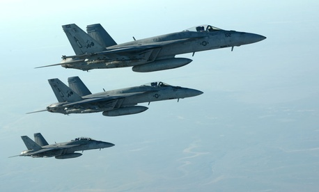 A formation of U.S. Navy F-18E Super Hornets fly over northern Iraq on Tuesday.