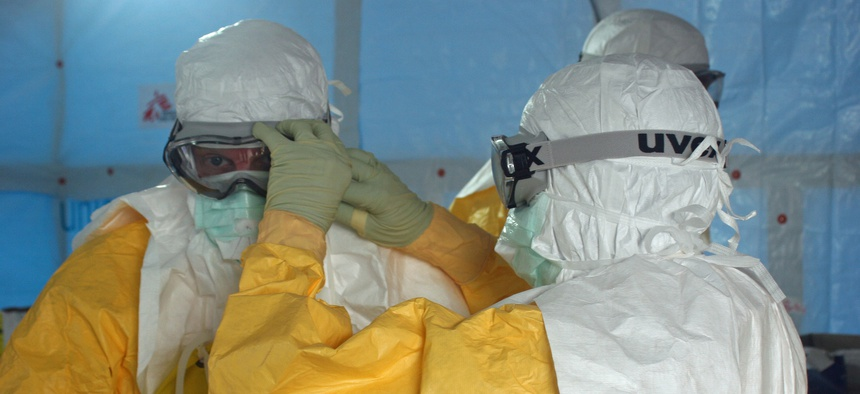 Doctors get ready to enter the Ebola unit in Liberia in August.