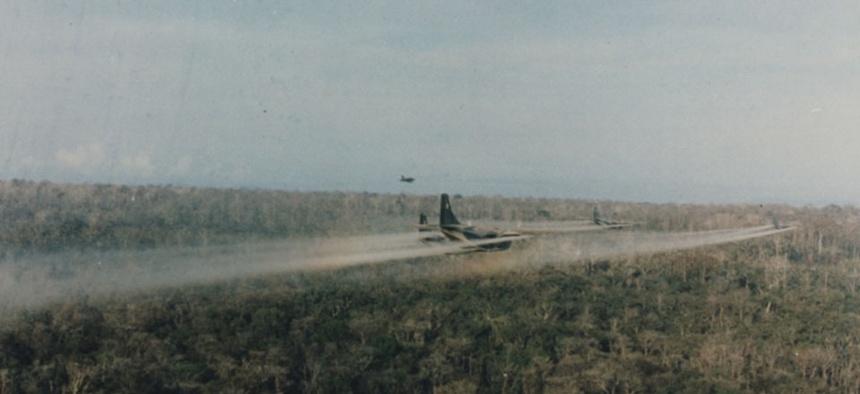 Group of U.S military C-123 aircraft spray Agent Orange during the Vietnam War.