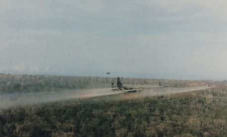Group of U.S military C-123 aircraft spray Agent Orange during the Vietnam War.