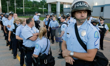 Police in riot gear prepare to take up positions during a protest in St. Louis in August.