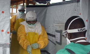 CDC officials don protective equipment when they enter a quarantine unit in Liberia in August.