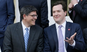Lew Jacob, left, with George Osborne Britain's Chancellor of the Exchequer, as they take part in the group photo for the G7 finance ministers and central bank governors in 2013.