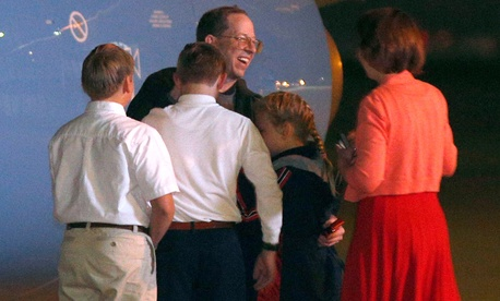 Jeffrey Fowle is greeted by family members upon his arrival in the United States Wednesday.