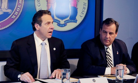 New York Governor Andrew Cuomo, left, speaks as New Jersey Governor Chris Christie listens at a news conference, Friday.