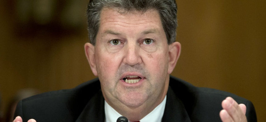 Postmaster General Patrick Donahoe defended USPS' decision to delay informing employees their personal data had been breached.