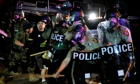 Police detain a man Aug. 18 during a protest in Ferguson.