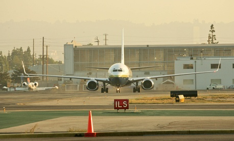 A plane lands at Bob Hope Airport, which is located somewhere in the Los Angeles area.