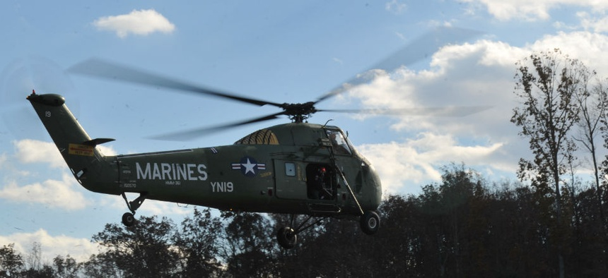 A Sikorsky helicopter lands at the National Museum of the Marine Corps.