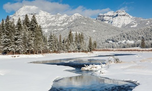Snow on Soda Butte Creek and the Absarokas in Yellowstone National Park.