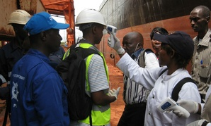 A team from CDC observes health screening at the Conakry Maritime Port in Guinea.