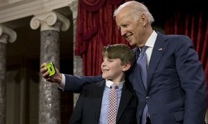 "Joe Biden takes a ""selfie"" with Sen. Jeanne Shaheen's grandson A.J. Bellabona  Tuesday."