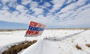 A sign protesting the Keystone XL pipeline stands in Nebraska in 2013.