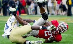 Georgia running back Brandon Boykin (2) is tackled by Georgia Tech defensive back Jemea Thomas (14) during the first half of an NCAA college football game in 2011.