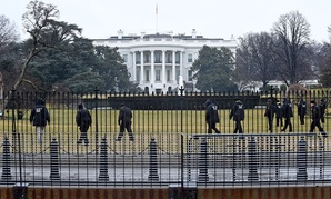 Secret Service officers search the grounds of the White House Monday.