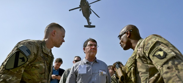 Then-Deputy Secretary of Defense Ashton Carter speaks with service members in Afghanistan, May 2013.