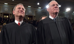 Chief Justice John G. Roberts and Supreme Court Justice Anthony M. Kennedy stand before President Barack Obama's State Of The Union address in January.