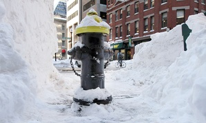 A fire hydrant sits cleared from surrounding snow in downtown Boston.