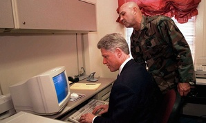 Col. Dan Houston shows President Clinton how to use a computer to send an e-mail to the troops at Camp Lejeune in 1996.