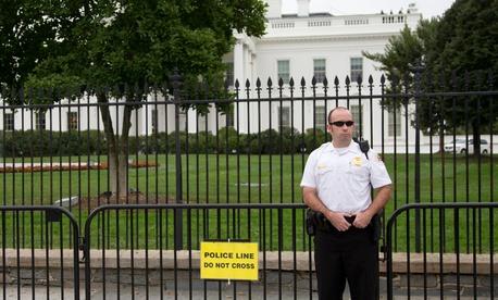 A Secret Service officer stands guard in October.