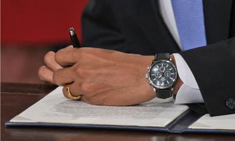 President Obama signs an executive order on transparency his first day on the job.