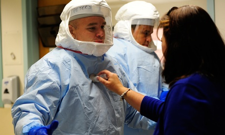 A Defense Department medical support team augmentation class trains on Ebola response in 2014 in Texas.
